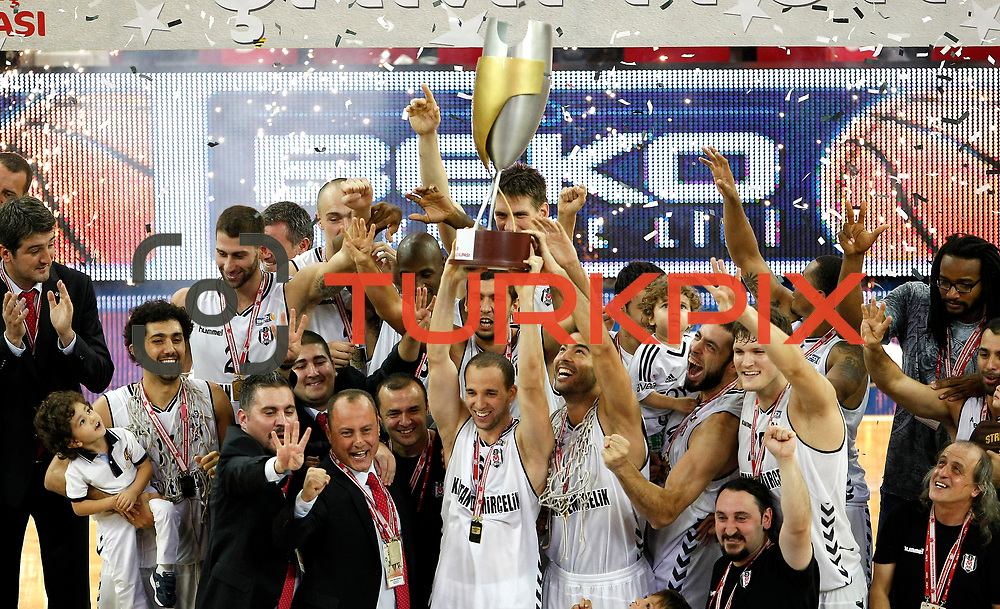 Besiktas's players lift the Presidential Cup Trophy during their 28. Men's Basketball Presidential Cup match Besiktas between Anadolu Efes at the Abdi ipekci Arena in Istanbul Turkey on Sunday 30 September 2012. Photo by TURKPIX