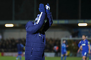 AFC Wimbledon coach Vaughan Ryan clapping whilst walking off the pitch during the EFL Sky Bet League 1 match between AFC Wimbledon and Doncaster Rovers at the Cherry Red Records Stadium, Kingston, England on 14 December 2019.