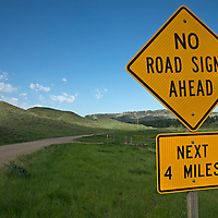 A road sign warns about no road signs ahead.