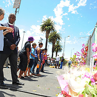 CAPE TOWN, SOUTH AFRICA - Saturday 7 December 2013, Executive Mayor of Cape Town, Mrs Patricia De Lille, and the Anglican Archbishop of Cape Town, Thabo Makgoba, read some of the condolence messages on some of the numerous bunches of flowers during a time of national mourning the death of the first democratically elected president, Nelson Mandela, in front of the Cape Town City Hall.<br /> Photo by Roger Sedres/ImageSA