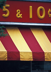 Colorful red and yellow store awning of small town old fashioned 5 & 10 cents store. CONCEPT STOCK PHOTOS CONCEPT STOCK PHOTOS