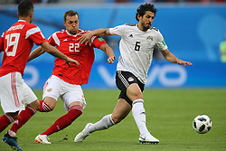 June 19, 2018 - Saint Petersburg, Russia - Artem Dzyuba (L) of the Russia national football team and Ahmed Hegazy of the Egypt national football team vie for the ball during the 2018 FIFA World Cup match, first stage - Group A between Russia and Egypt at Saint Petersburg Stadium on June 19, 2018 in St. Petersburg, Russia. (Credit Image: © Igor Russak/NurPhoto via ZUMA Press)