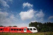 De trein van Arriva tussen Winterswijk en Arnhem ter hoogte van Duiven. De treindienst is een van de lijnen die is aanbesteed. Voorheen reed Syntus op het traject. Het is de enige goede openbaar vervoer verbinding tussen de Achterhoek en Arnhem. <br /> <br /> The train of Arriva is passing Duiven. The railway between Winterswijk and Arnhem is the only fast way of public transportation.