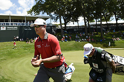 June 21, 2018 - Cromwell, CT, USA - Zach Johnson walks off the 18th green during the first round of the Travelers Championship on Thursday, June 21, 2018 at TPC River Highlands in Cromwell, Conn. Johnson shot a 63, making six birdies in a row on the back nine, and was the leader after the morning groups at -7. (Credit Image: © John Woike/TNS via ZUMA Wire)