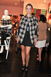 AMBER ATHERTON at the opening of the Kate Spade New York Store, 2 Symons Street, London on 1st September 2011.
