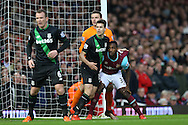 Marco van Ginkel of Stoke City and Michail Antonio of West Ham United tussle in the box before a corner is taken. Barclays Premier league match, West Ham Utd v Stoke city at the Boleyn Ground, Upton Park  in London on Saturday 12th December 2015.<br /> pic by John Patrick Fletcher, Andrew Orchard sports photography.