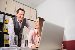 Man flirting with young woman in office