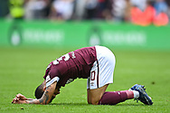 Josh Ginnelly (#30) of Heart of Midlothian FC looks dejected after the final whistle of the Cinch SPFL Premiership match between Heart of Midlothian and Hibernian at Tynecastle Park, Edinburgh, Scotland on 12 September 2021.