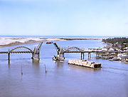 """ackroyd_C00922-1. """"Sause Bros. Barge Chetco going out to sea with load of lumber . Florence, Oregon. March 15, 1964"""