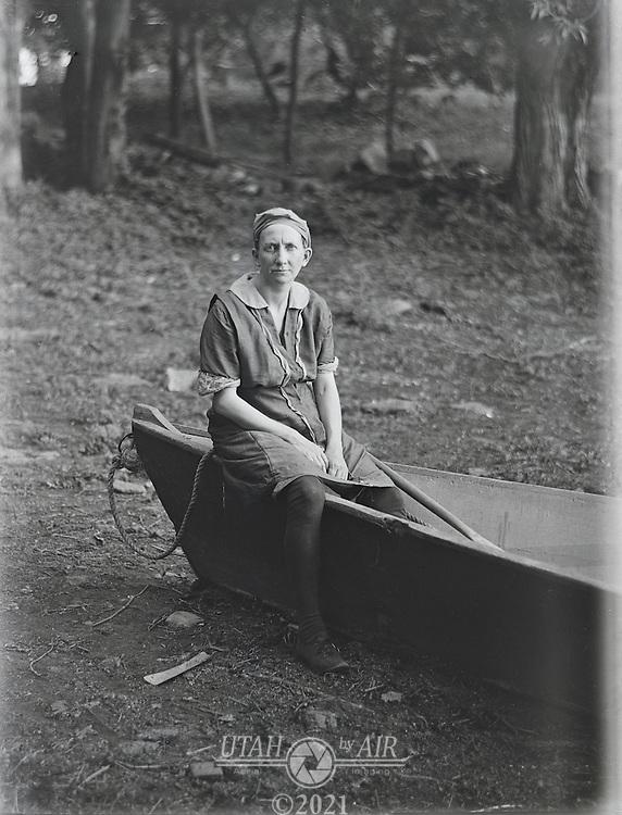 Wonam sitting on boat early 1900's