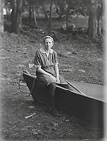 Wonam sitting on boat early 1900's