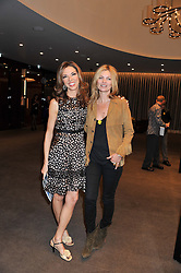 Left to right, HEATHER KERZNER and KATE MOSS at the launch of Samsung's NX Smart Camera at charity auction with David Bailey in aid of Marie Curie Cancer Care at the Bulgari Hotel, 171 Knightsbridge, London on 14th May 2013.