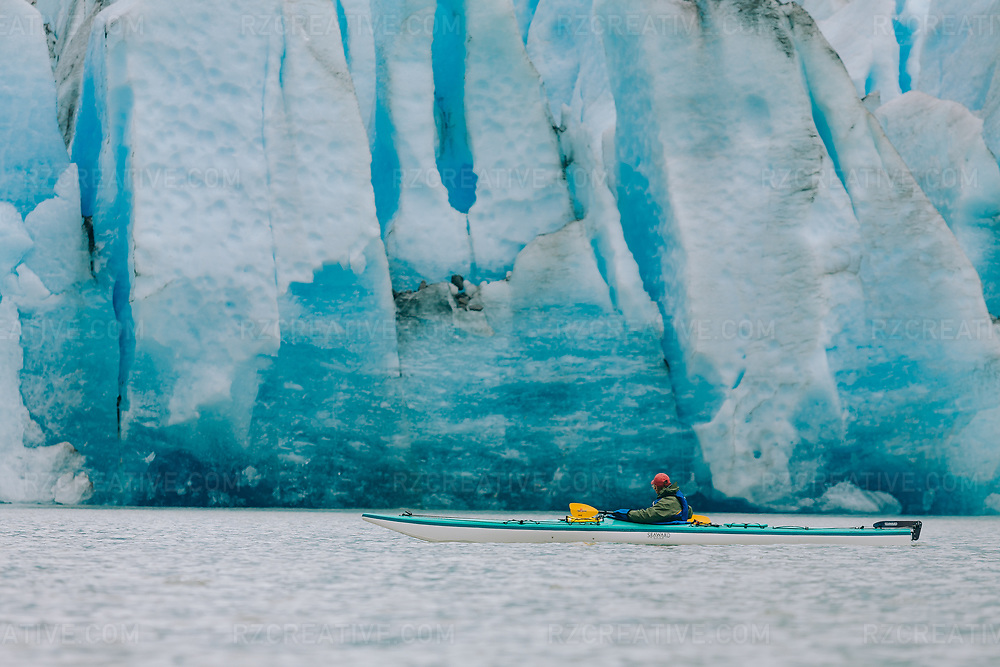 Sea kayak guide Corey Denton paddling southeast Alaska's Mendenhall Galcier.