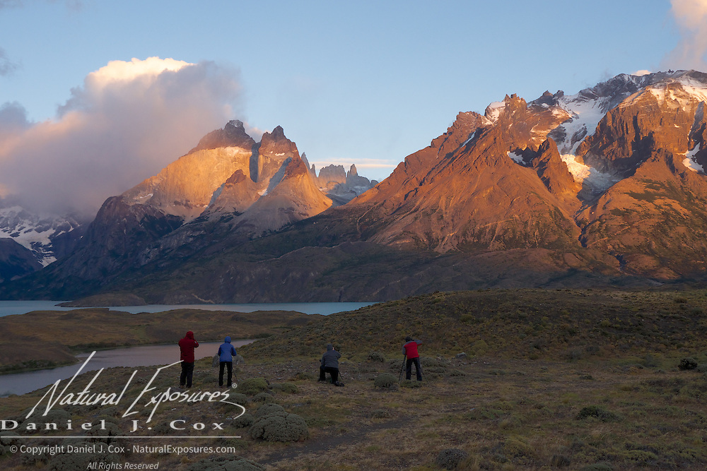 The NE crew crew works the beautiful mountains and the early morning alpenglow in Torres del Paine NP, Patagonia.