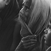 A Muslim woman. Islamic tradition insists she keep her head covered in the outside world or in the presence of men outside her family.  The strictest devotees in Bangladesh use a full-length Purdah. Bangladesh, 1977.