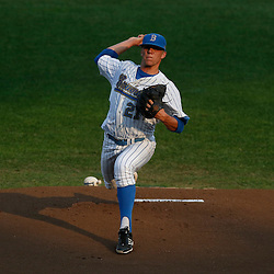 Jun 25, 2013; Omaha, NE, USA; UCLA Bruins starting pitcher Nick Vander Tuig (21) delivers a pitch during the first inning in game 2 of the College World Series finals against the Mississippi State Bulldogs at TD Ameritrade Park. Mandatory Credit: Derick E. Hingle-USA TODAY Sports