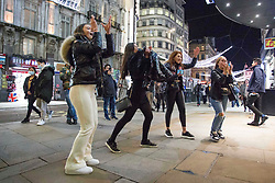 © Licensed to London News Pictures.15/12/2020. London, UK. Londoners making the most of the last night out in Leicester Square, before London will go into Tier 3 tomorrow. Photo credit: Marcin Nowak/LNP