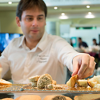 A member of staff displays some home made bread at one of the stands of the Biennale del Gusto on October 28, 2013 in Venice, Italy. The Biennale del Gusto is an exhibition held over four days, dedicated to traditional food and drinks from all regions of Italy.