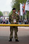 A soldier of the British army stand guarding the entrance to the volleyball venue in central London next to the IOC rings logo on day 4 of the London 2012 Olympic Games. A total of 18,000 defence personel were called upon to make the Games secure following the failure by security contractor G4S to provide enough private guards. The extra personnel have been drafted in amid continuing fears that the private security contractor's handling of the £284m contract remains a risk to the Games.