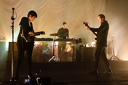 "© Licensed to London News Pictures. 16/12/2012. London, UK.   Romy Madley Croft (left), Jamie ""Jamie XX"" Smith (centre), and Oliver Sim (right) of The XX performing live at O2 Academy Brixton. The xx are an English indie band, formed in London in 2008.  In 2010, the band won the Mercury Music Prize for their debut album, xx.  The band is composed of Romy Madley Croft (vocals, guitar),  Oliver Sim (vocalis, bass) , and .Jamie ""Jamie XX"" Smith (percussion, producer). Photo credit : Richard Isaac/LNP"