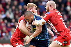 Wigan Warriors' Thomas Leuluai is tackled by Salford Red Devils' Daniel Murray and Salford Red Devils' Gil Dudson during the Betfred Super League match at the AJ Bell Stadium, Salford.