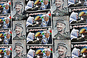 Posters of former Palestinian leader Yasser Arafat, current PA President Mahmoud Abbas, and the Haram es-Sharif in Jerusalem, on a wall of the Muqata compound, the PA headquarter and last residence of Yasser Arafat, in the Palestinian capital Ramallah, on Friday, Nov. 11, 2005. Here, where Arafat is buried, a mausoleum and a museum in his honour will be built soon. **ITALY OUT**