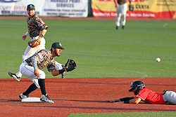 29 July 2016: Connor Oliver slides well short of 2nd base getting caught and put out by a tag from Santiago Chirino during a Frontier League Baseball game between the Lake Erie Crushers and the Normal CornBelters at Corn Crib Stadium on the campus of Heartland Community College in Normal Illinois