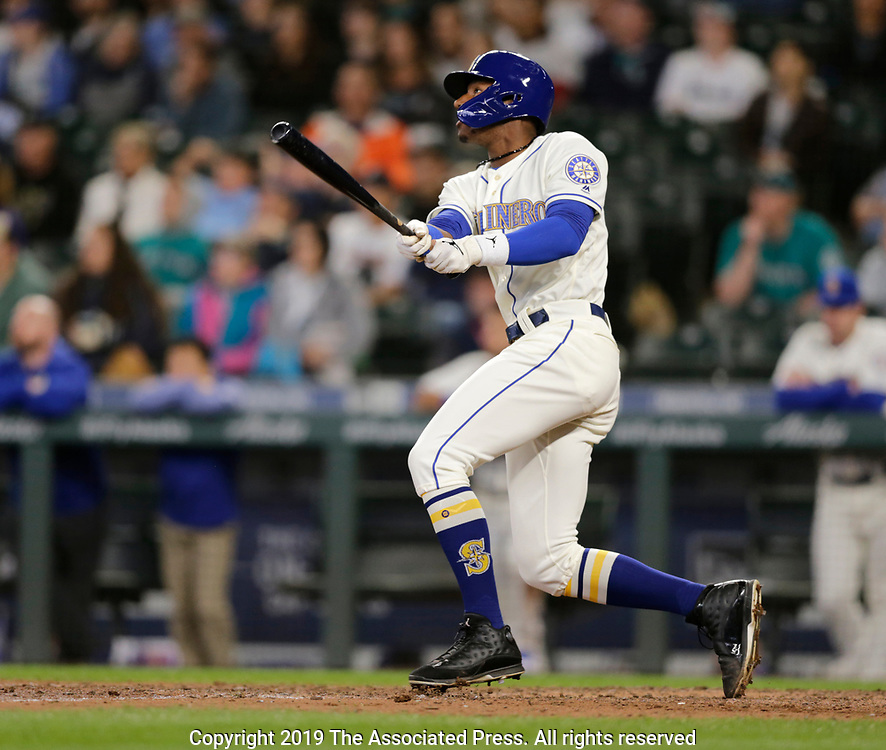 Seattle Mariners' Kyle Lewis hits a three run home run against the Chicago White Sox during a baseball game, Sunday, Sept. 15, 2019, in Seattle. (AP Photo/John Froschauer)