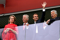 France President Emmanuel Macron (second right) waves from the stands