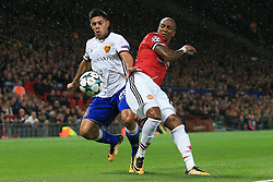 12th September 2017 - UEFA Champions League - Group A - Manchester United v FC Basel - Blas Riveros of Basel battles with Ashley Young of Man Utd - Photo: Simon Stacpoole / Offside.
