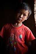 A Tibetan boy poses in a window in Dawu, Tibet.