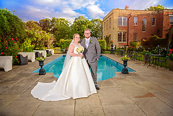 The happy couple pictured in the beautiful landscaped grounds at Shortmead House