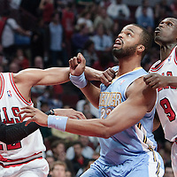 08 November 2010: Chicago Bulls' forward #22 Taj Gibson fights for the rebound with Chicago Bulls' small forward #9 Luol Deng against Denver Nuggets' power forward #23 Shelden Williams during the Chicago Bulls 94-92 victory over the Denver Nuggets at the United Center, in Chicago, Illinois, USA.