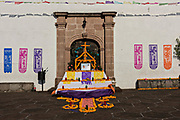 A Day of the Dead altar decorated with marigolds honoring Pope John Paul II in Santa Clara del Cobre, Michoacan, Mexico.