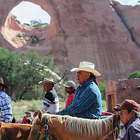 """072114  Adron Gardner/Independent<br /> <br /> Tségháhoodzání, the Window Rock, backdrops riders who, as Navajo Nation Tribal Council speaker Pro-Tem Lorenzo Bates said, """"arrived from all four directions"""" for the start of the summer session of the Navajo Nation Tribal Council in Window Rock Monday."""