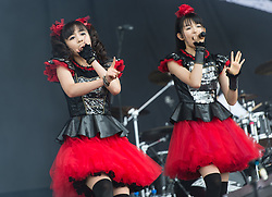 © Licensed to London News Pictures. 29/08/2015. Reading Festival, UK.  Babymetal performing at Reading Festival 2015, Day 2.  In this picture - Maometal (left), Sumetal (right). Photo credit: Richard Isaac/LNP