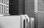 The solitary of a man stands on the roof of an office building in downtown Atlanta during a victory parade for the city's baseball team.