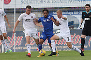Peterhead's Niah Payne (14) Cove Rangers' Harry Milne (3) and Cove Rangers' Rory McAllister (13) battles for possession, tussles, tackles, challenges, during the Premier Sports Scottish League Cup match between Peterhead and Cove Rangers at Balmoor, Peterhead, Scotland on 17 July 2021.