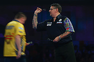 Gary Anderson throwing against Dave Chisnall during the World Darts Championships 2018 at Alexandra Palace, London, United Kingdom on 29 December 2018.