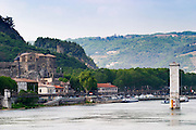 The Chateau de Tournon in the town Tournon and in the background a tower in ruins. Build in the 14th fourteenth and 15th fifteenth century by the Seigneurs de Tournon. The river Rhone and the pedestrian bridge M Seguin.  Tournon-sur-Rhone, Ardeche Ardèche, France, Europe