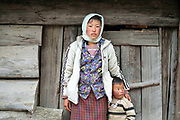Portrait of sheep farmer Dawa Zam and her son Ngawang Thinley in Namephey village in the remote Phobjikha valley, Bhutan. With the easy availability of commercially processed wool and other alternatives for fabric for weaving, and the lack of human resources to look after the sheep, farming of sheep has gradually been in decline in Bhutan.