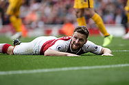 Shkodran Mustafi Of Arsenal is left grounded.<br /> Premier league match, Arsenal v Brighton & Hove Albion at the Emirates Stadium in London on Sunday 1st October 2017. pic by Kieran Clarke, Andrew Orchard sports photography.