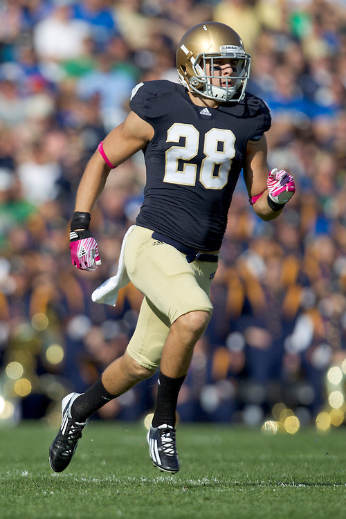 Notre Dame safety Austin Collinsworth (#28) runs down the field in action during NCAA football game between Notre Dame and Air Force.  The Notre Dame Fighting Irish defeated the Air Force Falcons 59-33 in game at Notre Dame Stadium in South Bend, Indiana.