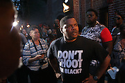 New York, NY- July 23: Protestor attends the funeral of Eric Garner, who fell victim to tactics of the NYPD who died after NYPD cop rendered him in chokehold on July 20, 2014 in Staten Island. His funeral was held on July 23, 2014 at Bethel Baptist Church in New York City.  (Terrence Jennings)