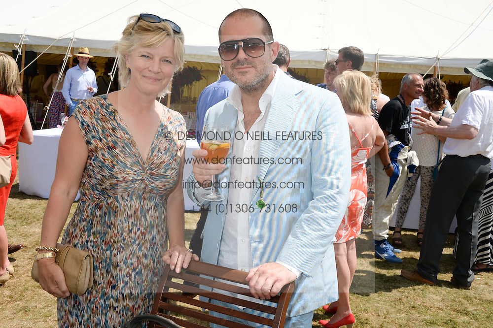 The COUNTESS OF MARCH and SIR JONATHAN IVE at the Cartier 'Style et Luxe' part of the Goodwood Festival of Speed, Goodwood House, West Sussex on 14th July 2013.