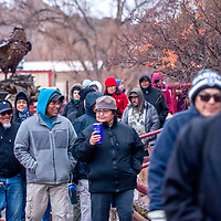Visitors leave the aviary during a Winter Stories and songs tour at the Navajo Nation Zoo in Window Rock Wednesday.