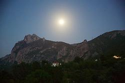 Moon Setting On Mountains