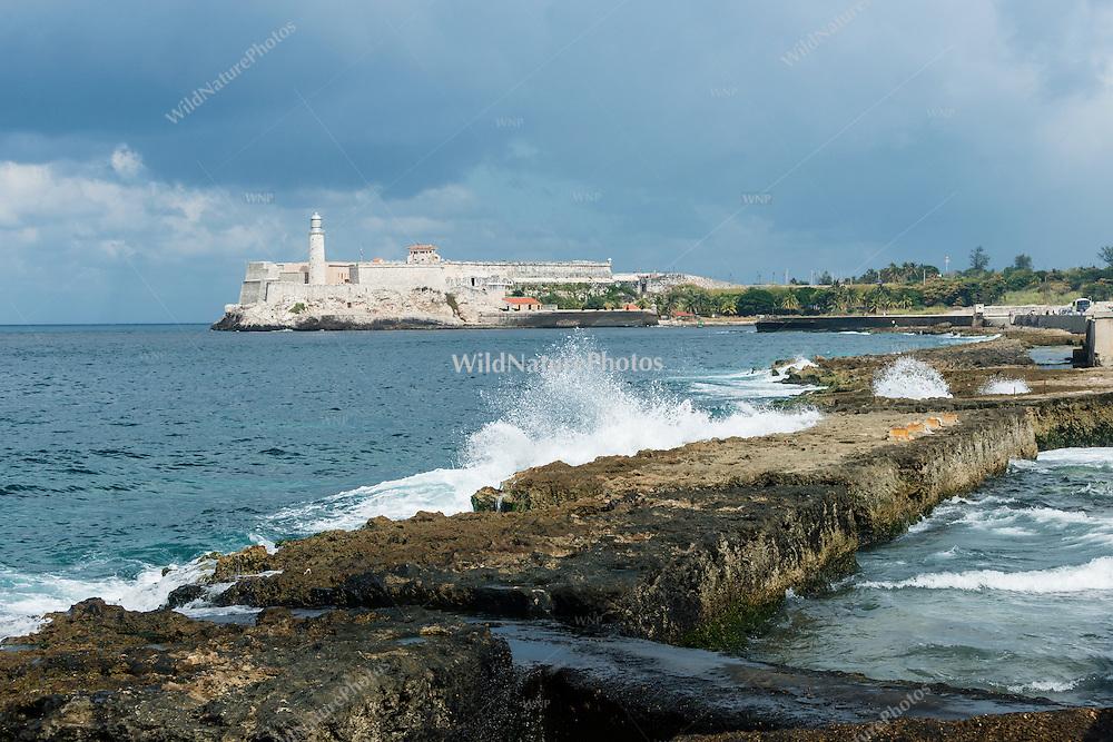 Waves splash on the breakwater off the Malecon in Havana, Cuba.
