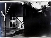 woman sitting on porch rural USA 1920s