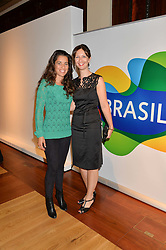 Left to right, JIMENA PARATCHA former wife of Jimmy Page and TIFFANY GARSIDE at the Art of Futebol - a charity auction of 11 footballs signed by 11 Brazilian legends from Pele to Neymar & decorated and designed by 11 leading contemporary artists in aid of Action for Brazil's Children Trust held at the Brazilian Embassy, 16 Cockspur Street, London on 10th July 2014.